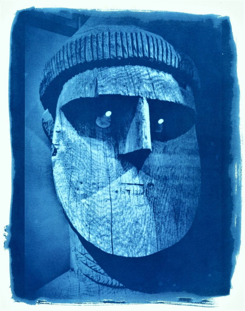 Cyanotype print of a Pacific Island traditional wooden head sculpture